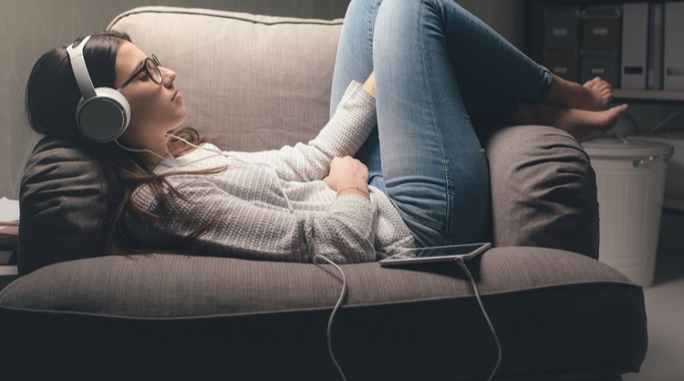 woman relaxing while listening to music
