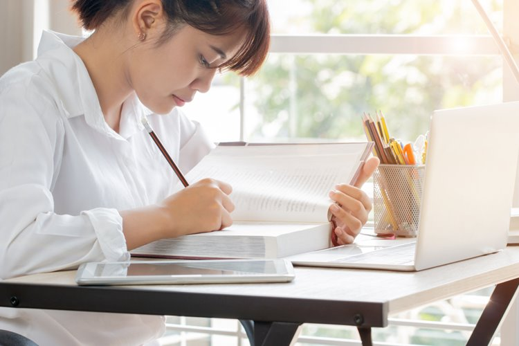 young asian woman studying