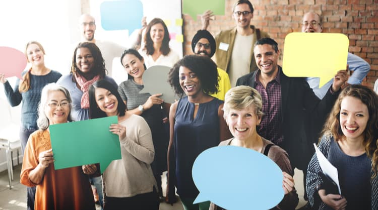 diverse colleagues smiling holding speech bubbles