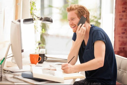 ginger haired man talking on phone