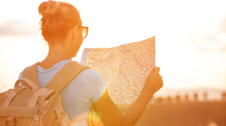 young woman looking at world map