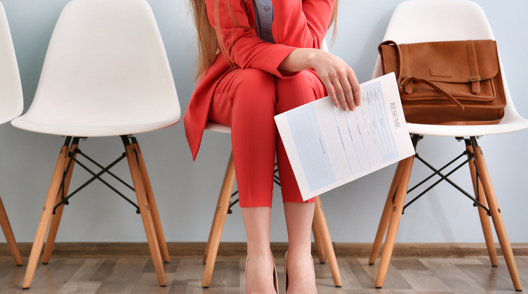 woman waiting for interview holding resume