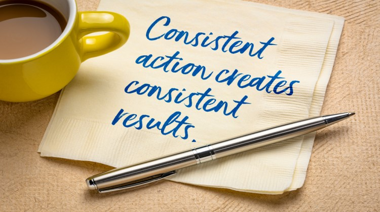 quote about consistency printed on napkin