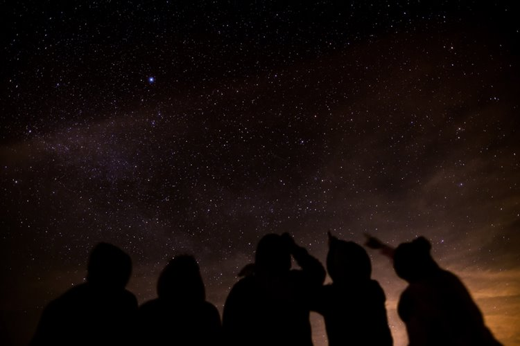 group of friends stargazing