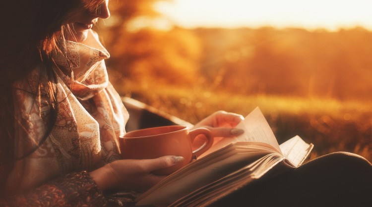 woman reading in autumn setting
