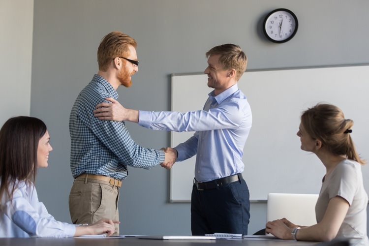 CEO giving handshake to employee