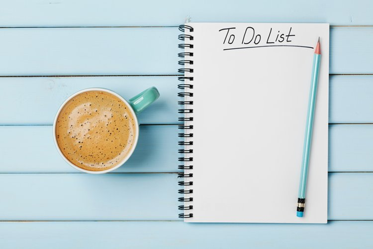 to-do list notebook on blue wooden table