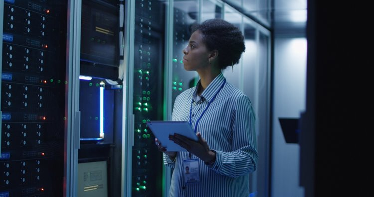 dark-skinned woman overseeing IT systems