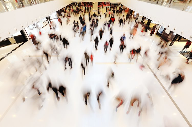 blurred customers in shopping centre