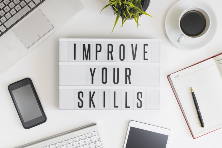 'improve your skills' sign flatlay