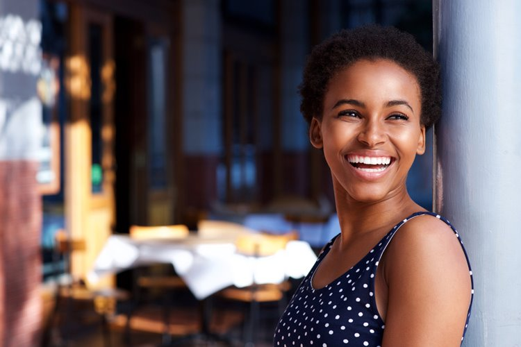 dark-skinned woman smiling