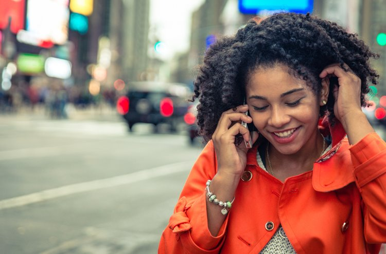dark-skinned woman chatting on phone