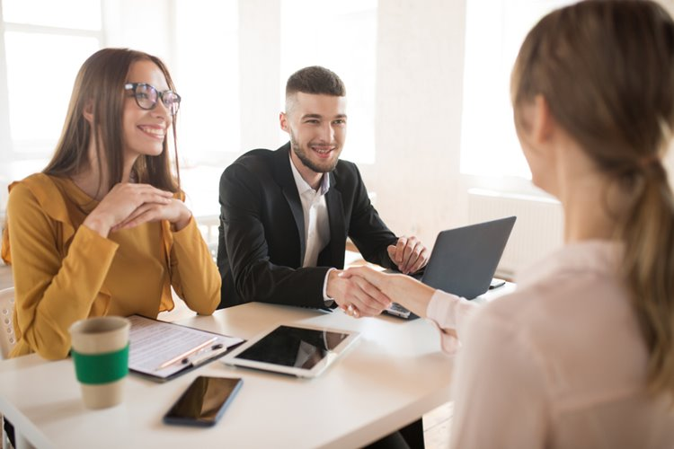 woman and man hiring managers interviewing potential candidate