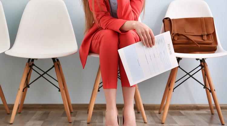woman waiting for job interview holding resume