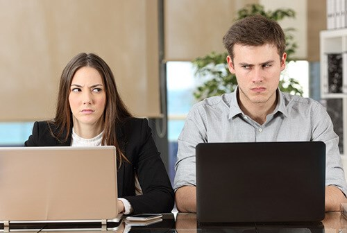 colleagues side by side looking at each in disgrace