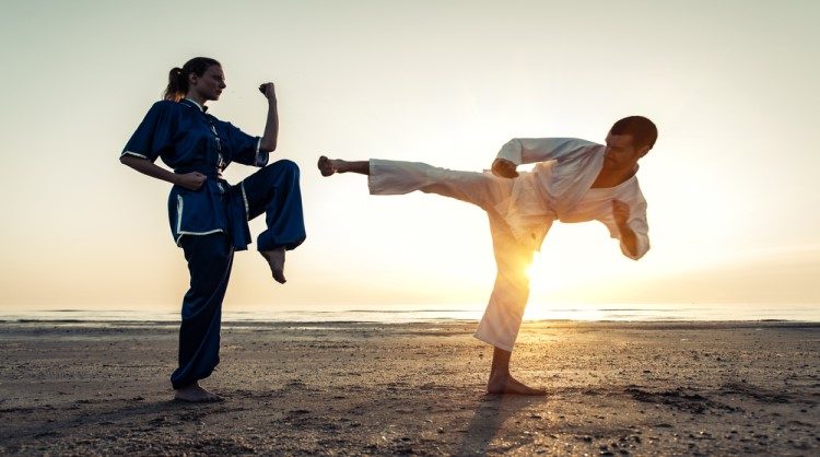 couple training in martial arts