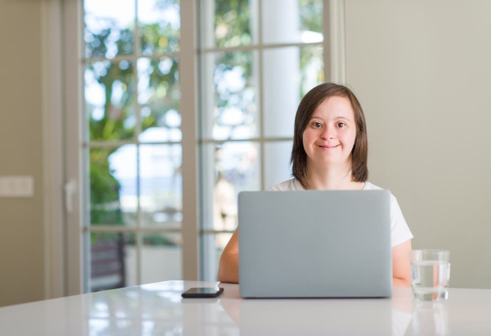 woman with down syndrome working from home