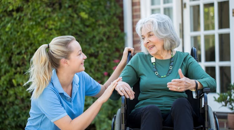 woman carer looking after elderly woman