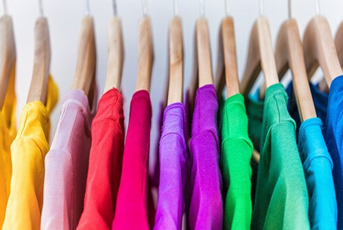 colourful shirts on clothes rack