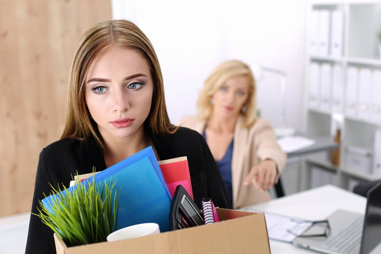 young female employee dismissed from job