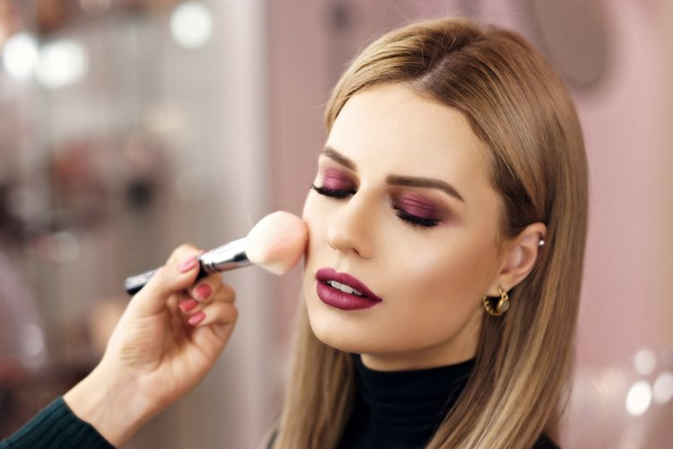 client receiving professional makeup services