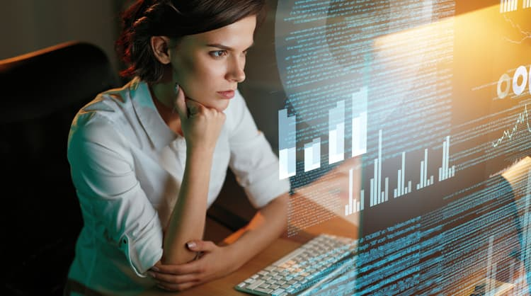 woman looking at data on screen