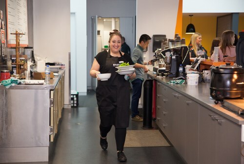 female hospitality worker smiling