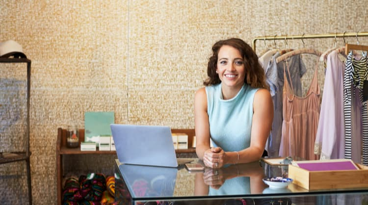 woman business owner at clothes shop