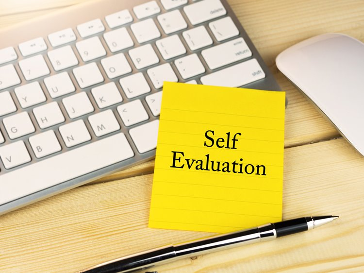 self evaluation typed on yellow sticky note