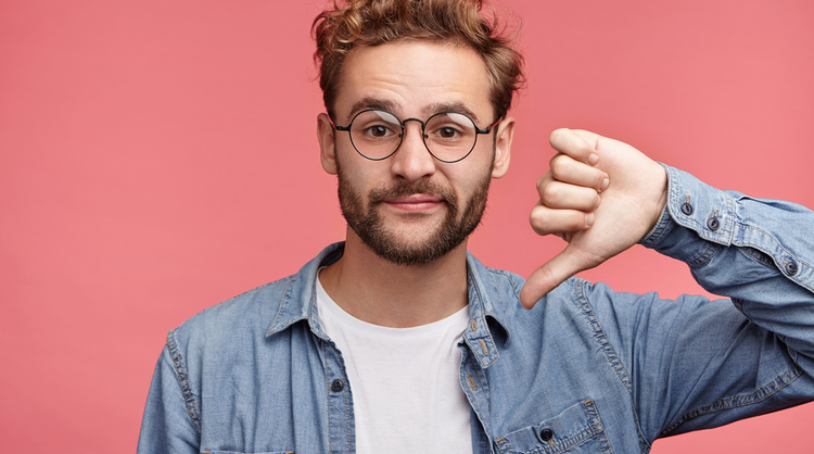 guy with glasses putting thumbs down