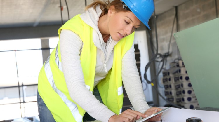 woman construction worker overseeing project paperwork
