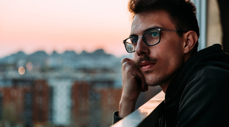 man with glasses thinking