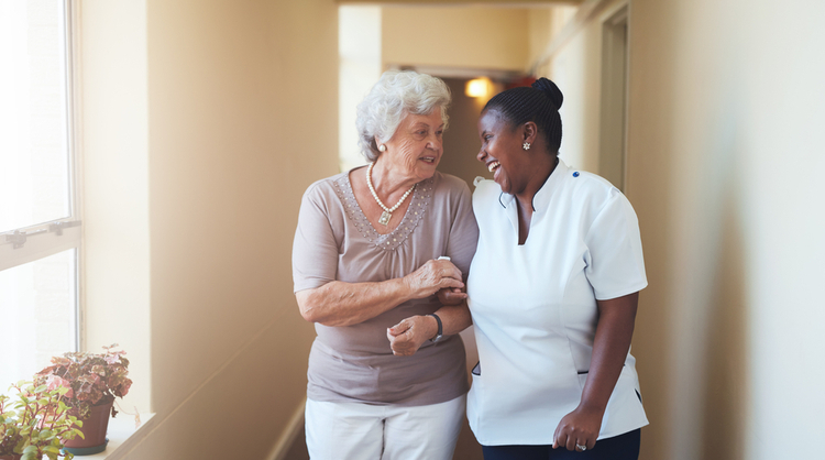 african american woman caregiver assisting patient