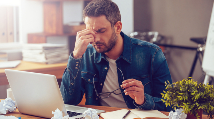 male employee feeling frustrated with workload