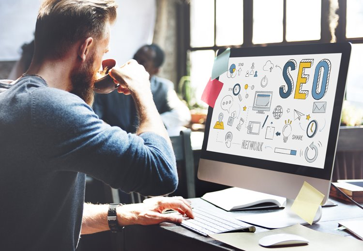 man with beard working on SEO