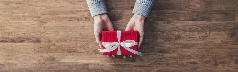 person offering wrapped present