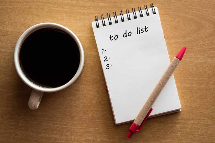 to-do list with black coffee
