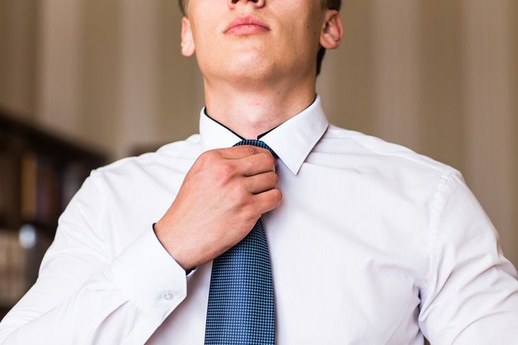 young man fixing up tie