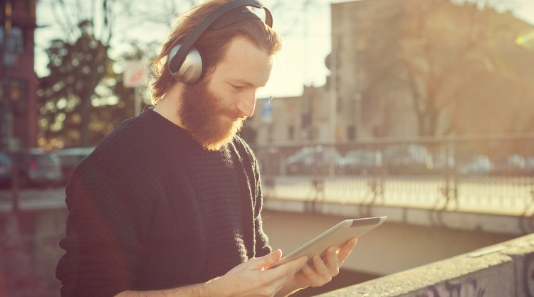 bearded man listening to music outside