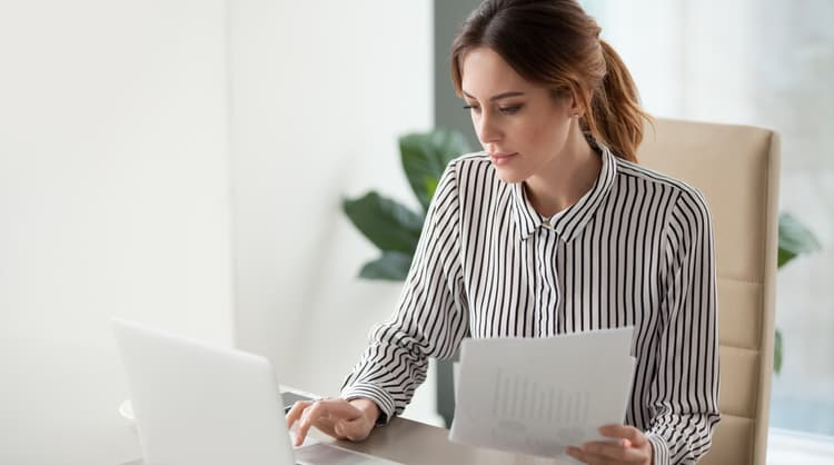 office woman working on laptop