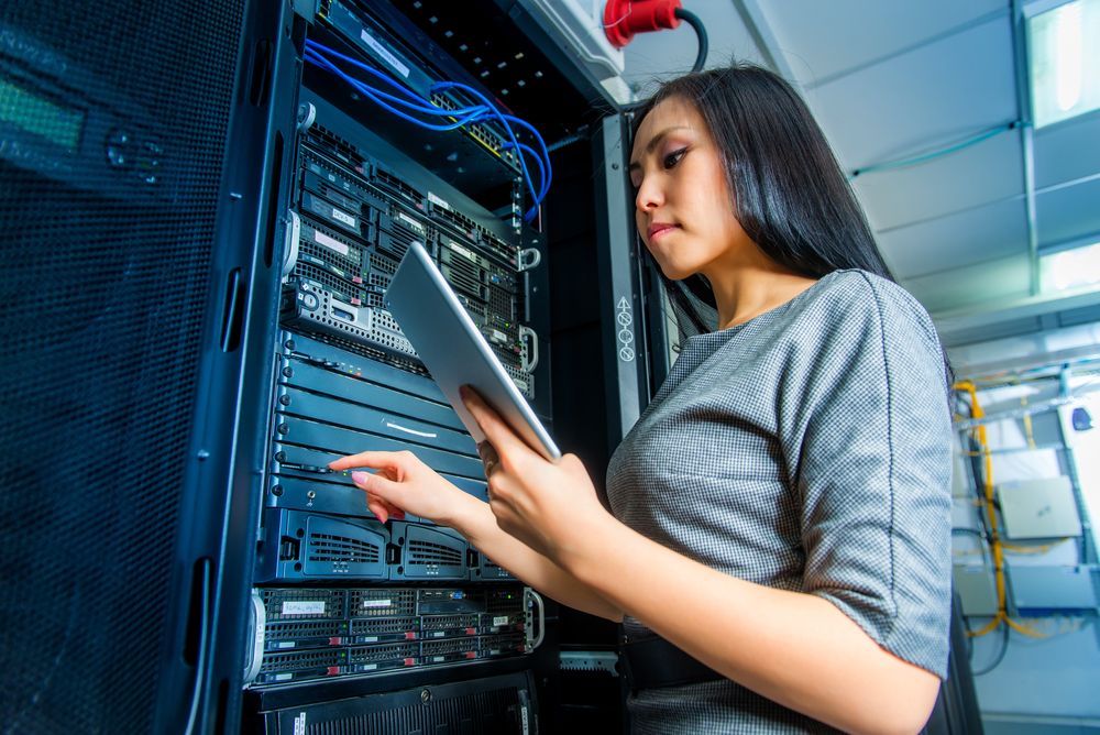 young asian woman network computer engineer working