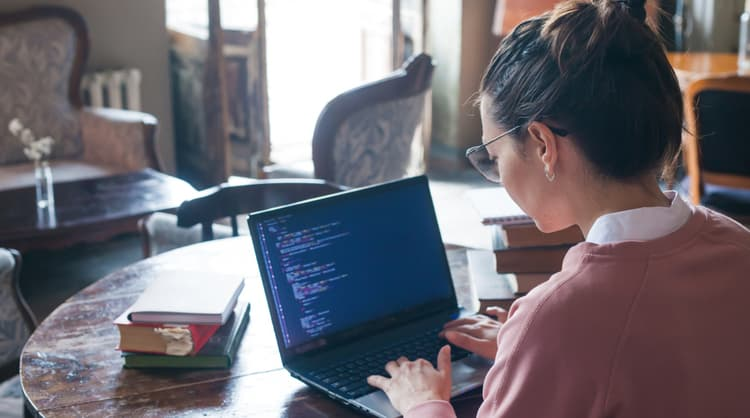 woman learning how to code at home